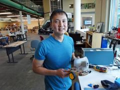 Peter Chang shows off class project. 