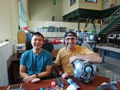 Peter Chang helps Ian Milward at Hacker Lab Sierra College. 