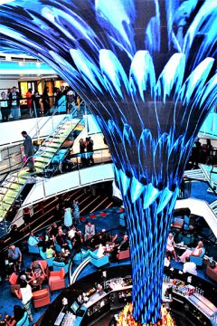 """""""Dreamscape,"""" a 24-foot-tall, funnel-shaped sculpture clad in LED panels, will wow passengers on the Carnival Panorama, as it does on the Carnival Vista. Photo by David Dickstein"""