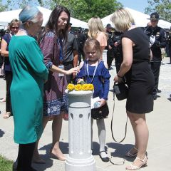 Stasyuk Family at Officer Mark Stasyuk's memorial – yellow flowers were placed by family members during ceremony.