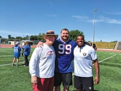Left to right: Playmakers founder Coach Roz, Harrison Phillips of the Buffalo Bills, and Jordan Richards of the Oakland Raiders use football to teach kids about character.