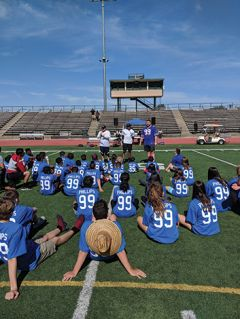 NFL players Harrison Phillips and Jordan Richards introduce kids to the Playmakers football camp held on June 15 at El Camino High School.