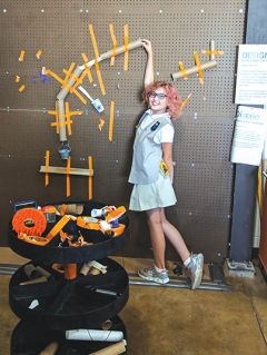 Kaitlyn Williams practices her engineering skills at the marble machine in the Sacramento STEM Center + MakerSpace.