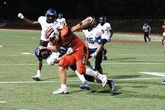 Lancer James Feao returns a kick from the Blue Devils. Photo by Rick Sloan