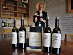 Marija Jovanovic, a VIP/trade coordinator for Stag's Leap Wine Cellars, proudly pours cabs from the Estate Collection at the winery's busy visitor center in the Stags Leap District. Photo by David Dickstein
