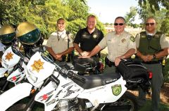 Park Ranger Luevano and his Sergeant Elmer Marzan arrived in style on their sport utility vehicles to join their Commander Wade Derbe and Chief Michael Doane in the celebration. Photo courtesy Mather Alliance