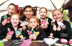 Students of the KM Dance Arts studio made ballerina paper dolls in their Founders Day booth. Photo by Susan Maxwell Skinner