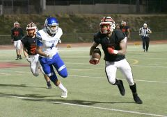 Wide receiver and all-around athlete Brandon Gray #1 provided his team with both its scores in the fourth quarter on Friday, November 1. Photo by Rick Sloan