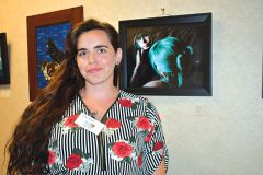 """""""I'm just very happy that I got to enjoy this experience,"""" said Erika Traen at the Artist Reception. She is shown with her photograph titled """"Self Portrait.""""  Photo by Rick Sloan"""